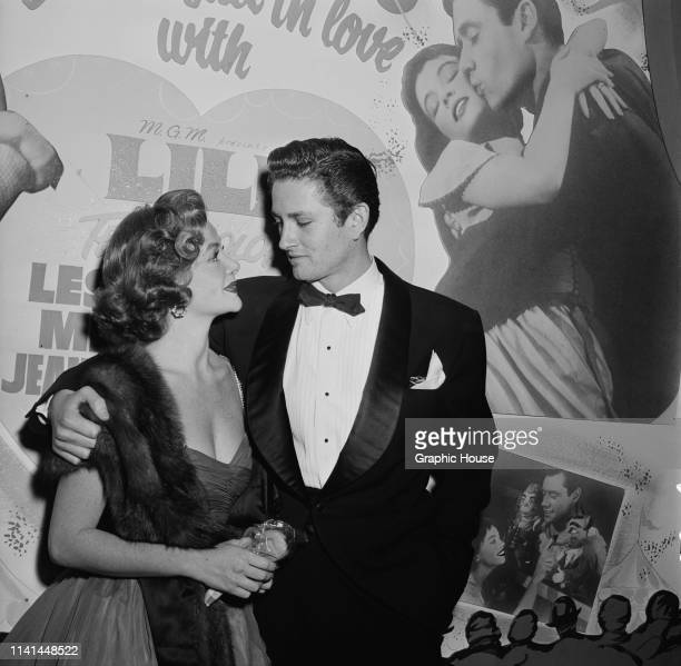 American actress Dorothy Malone and actor Sydney Chaplin attend the premiere of American film 'Lili' US 10th March 1953
