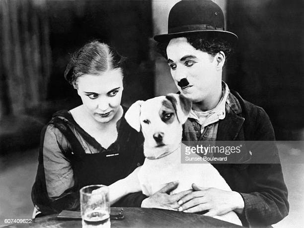 American actress Edna Purviance with British actor director screenwriter and producer Sir Charles Spencer Charlie Chaplin on the set of his movie A...