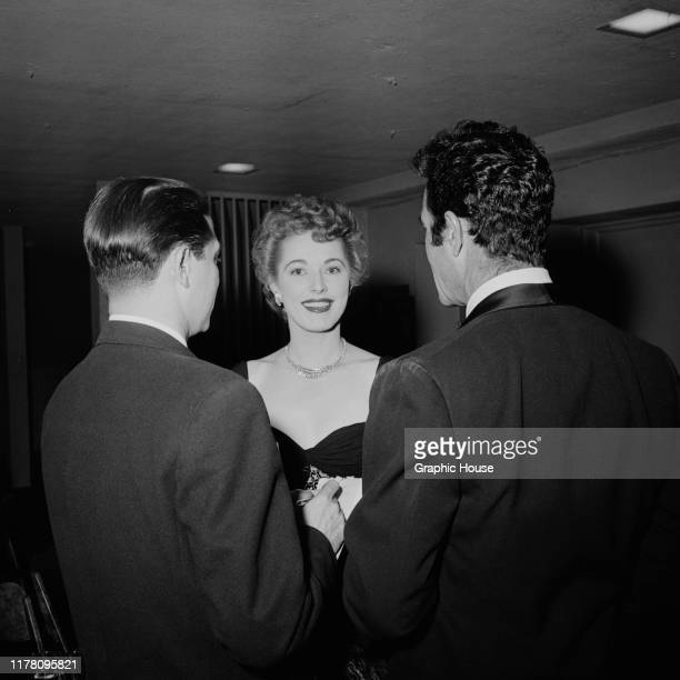 American actress Eleanor Parker with two men, circa 1955.