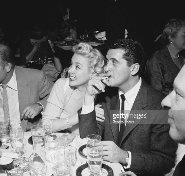 American actress Elena Verdugo and actor and comedian Hal March at the opening night of Sammy Davis Jr's run at Ciro's restaurant in West Hollywood...