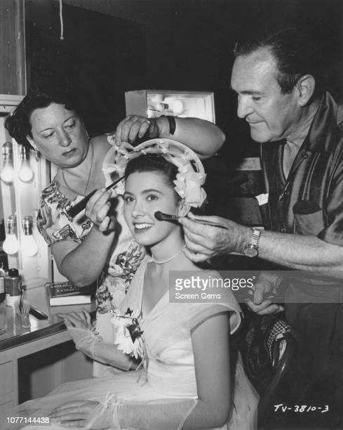 American actress Elinor Donahue receives the attention of hair stylist Hazel Keats and makeup artist Ray Sebastian on the set of 'Grandpa Jim's...