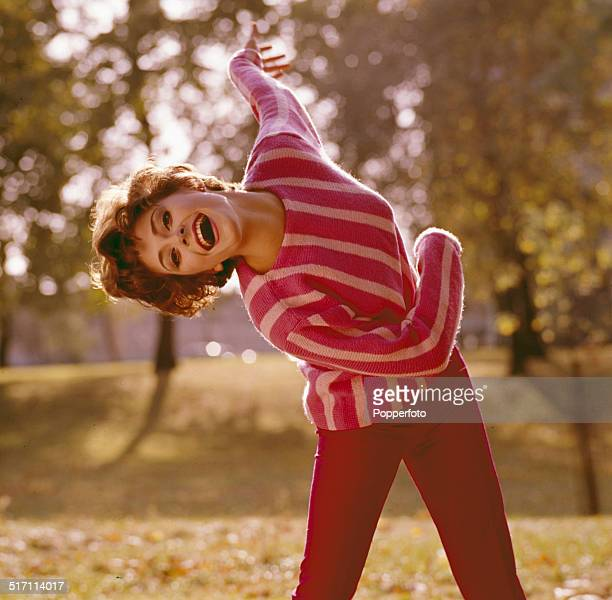 American actress Elizabeth Ashley posed wearing a striped pink jumper in London in 1965