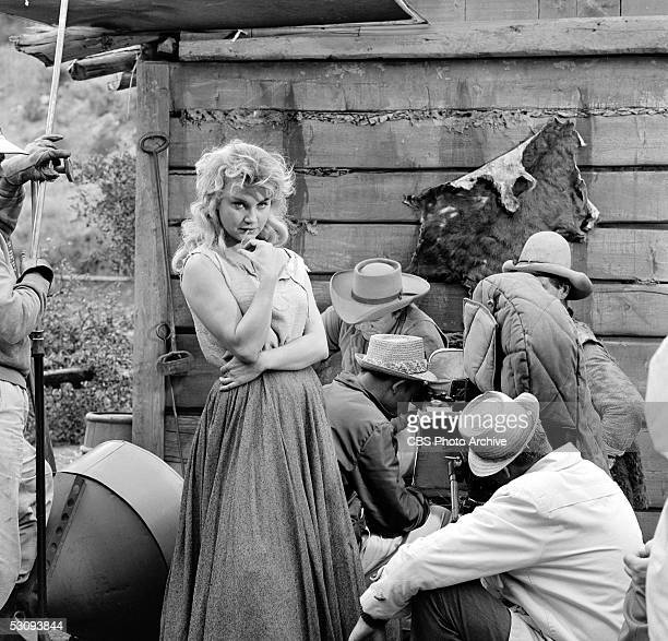 American actress Elizabeth MacRae waits while the crew checks equipment during the taping of the episode 'Us Haggens' for the TV western 'Gunsmoke'...
