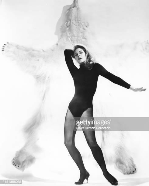 American actress Elizabeth Montgomery poses against a polar bear rug circa 1963
