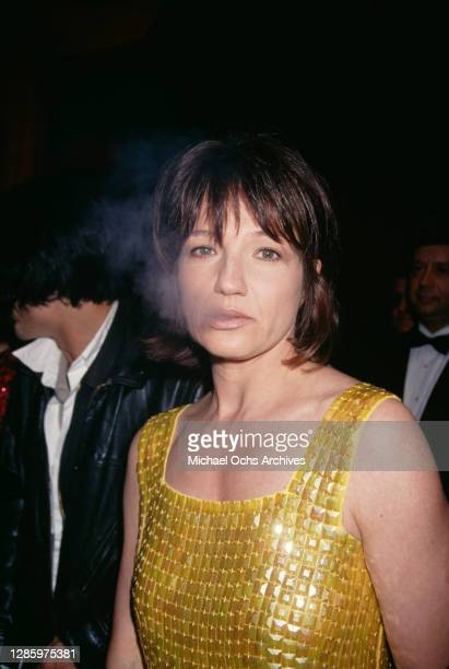 American actress Ellen Barkin exhales cigarette smoke as she attends the AIDS Project Los Angeles Fashion Show honouring Isaac Mizrahi, held at...