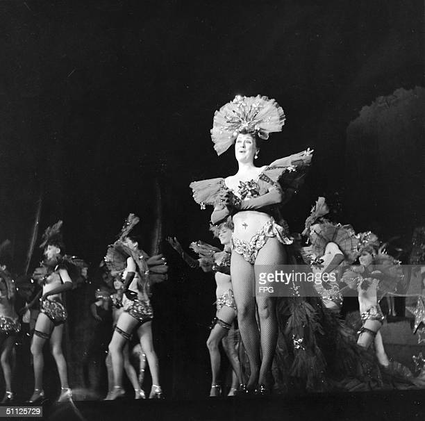 American actress entertainer and author Gypsy Rose Lee sign on stage during a scene from 'Star Garter' at the Music Box Theatre New York New York...