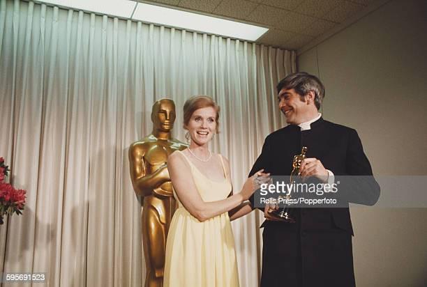 American actress Eva Marie Saint pictured standing with Australian actor and costume designer John Truscott at the 40th Academy Awards at the Santa...