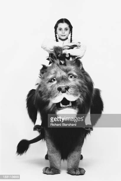 American actress Fairuza Balk poses atop the Cowardly Lion in a publicity still for the film 'Return to Oz' 1985