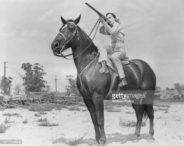 American actress Faith Domergue riding sidesaddle during rehearsals for a scene in the RKO Radio Pictures film 'Vendetta' circa 1949