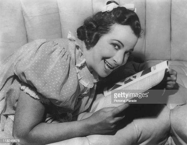 American actress Fanny Brice as 'Baby Snooks' reading a magazine circa 1930