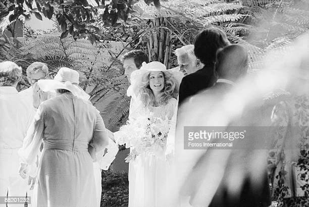 American actress Farrah Fawcett is escorted by her father James Fawcett at her wedding to actor Lee Majors at the Hotel BelAir Los Angeles California...
