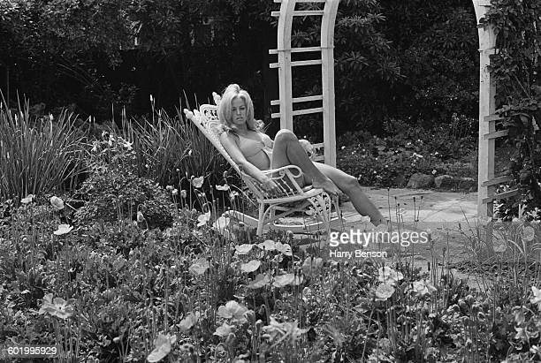 American actress Farrah Fawcett relaxing in the garden USA 4th May 1970