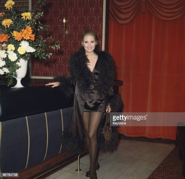 American actress Faye Dunaway attends the Royal European charity premiere of the film 'Camelot' at the Warner Theatre in London 16th November 1967