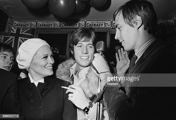 American actress Faye Dunaway switches on the lights in Carnaby Street London 17th November 1967 Here she is interviewed by British television...