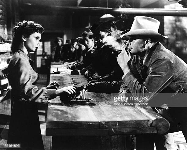 American actress Felicia Farr as Emmy and Canadianborn American actor Glenn Ford as Ben Wade in '310 To Yuma' directed by Delmer Daves 1957