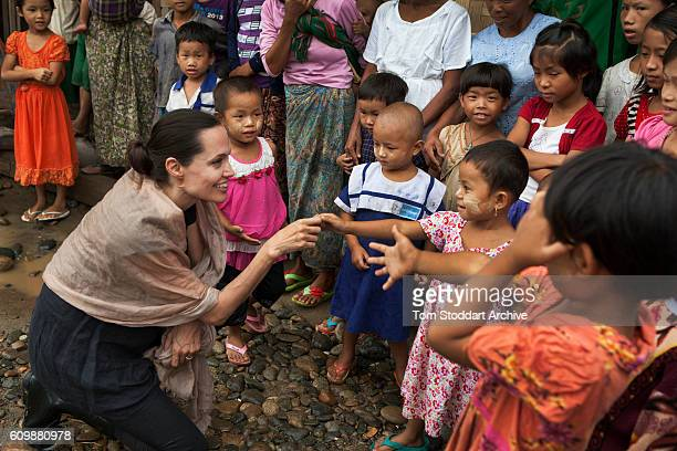 American actress film director and United Nations Special Envoy Angelina Jolie meets with children during a visit to the Ja Mai Kaung Baptist refugee...