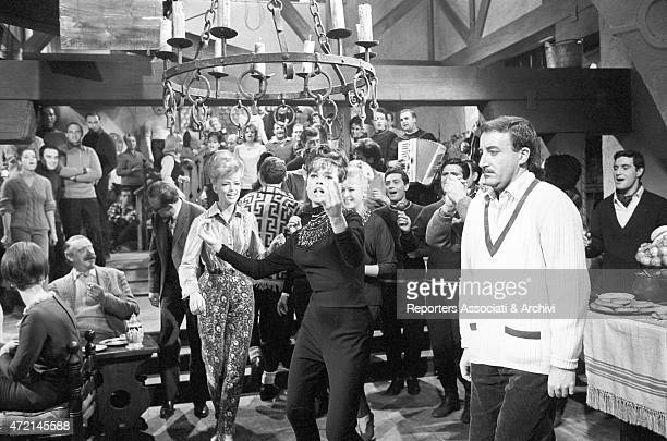 'American actress Fran Jeffries singing and dancing involving the British actor Peter Sellers following her clumsily in a scene from the film 'The...