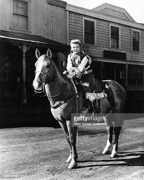 American actress Gail Davis on horseback in the title role of the American TV western series 'Annie Oakley' circa 1955