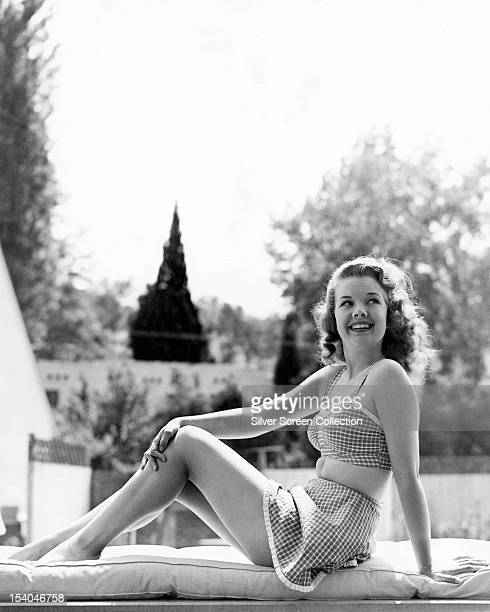 American actress Gale Storm in a twopiece swimming costume circa 1955