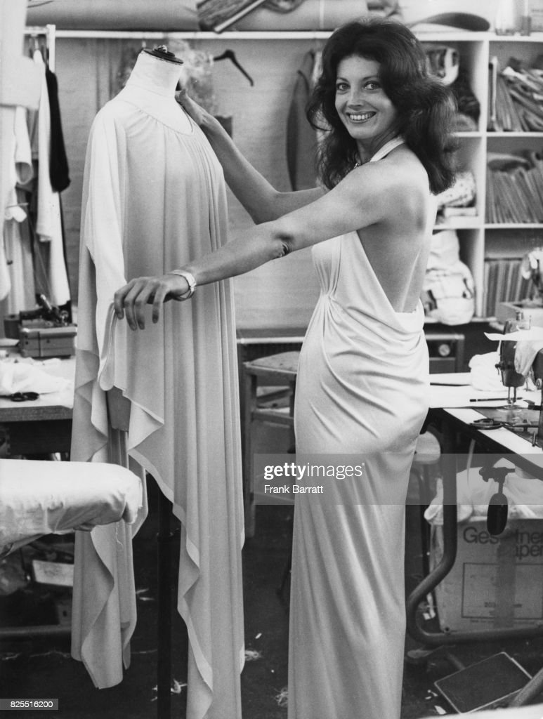 American actress Gayle Hunnicutt in the workshop of fashion designer Yuki, who will be designing the costumes for her new film 'Once in Paris', 13th October 1977. Yuki (Yuki Torimaru) has already designed a private wardrobe for Hunnicutt.