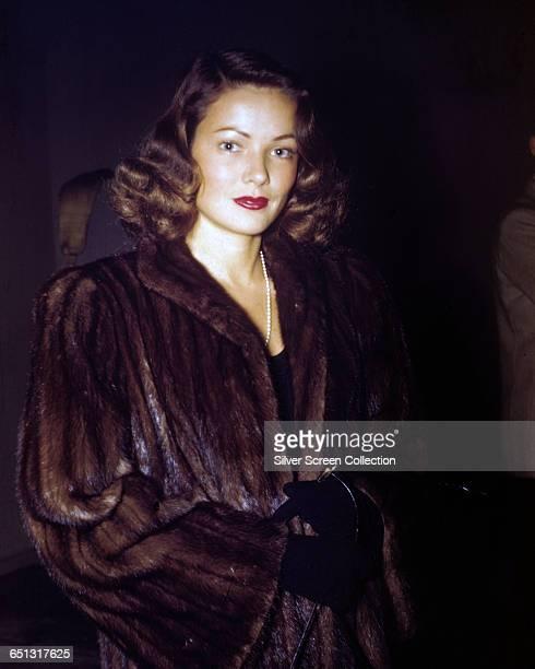 American actress Gene Tierney wearing a fur coat circa 1945