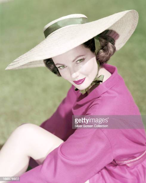 American actress Gene Tierney wearing a widebrimmed sunhat circa 1945