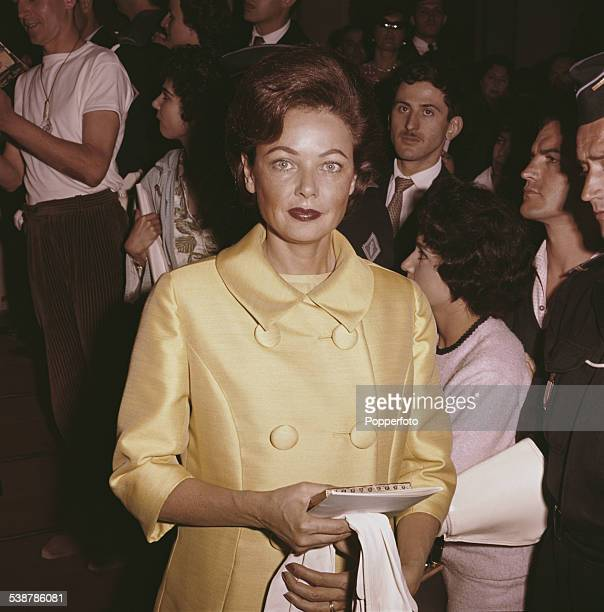American actress Gene Tierney who plays the character of Dolly Harrison in the film 'Advise Consent' pictured wearing a lemon yellow coat at the...