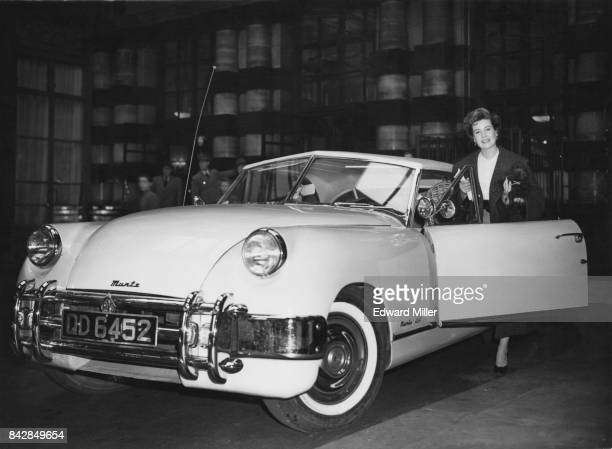 American actress Gloria DeHaven gets into her pink Muntz Jet outside the Savoy Hotel in London bound for Dover and the Continent 22nd April 1952