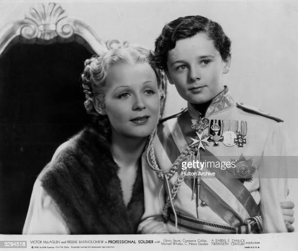 American actress Gloria Stuart formerly Gloria Stuart Finch shares a loving moment with child actor Freddie Bartholomew formerly Frederick Llewellyn...