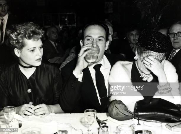 American actress Gloria Swanson is unable to hide her disappointment at losing out to Judy Holliday in the 23rd Annual Academy Awards for Best...