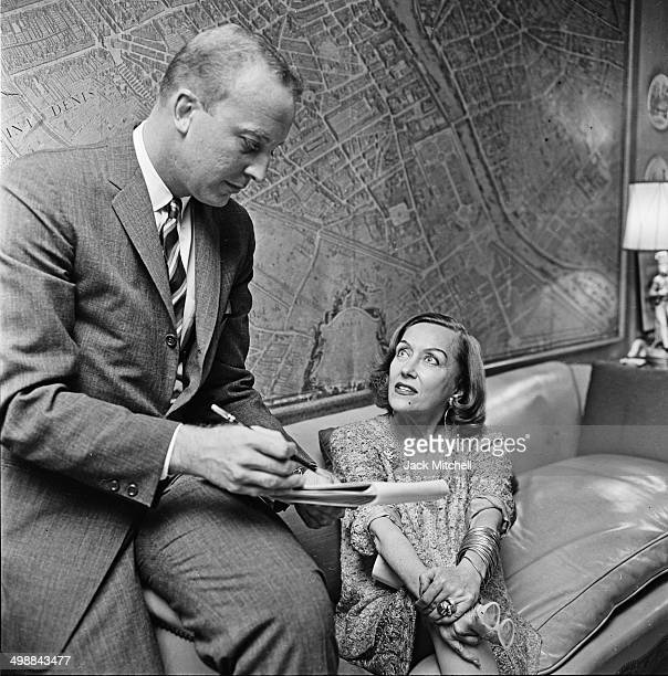 American actress Gloria Swanson meets with a business associate in her home New York New York 1961