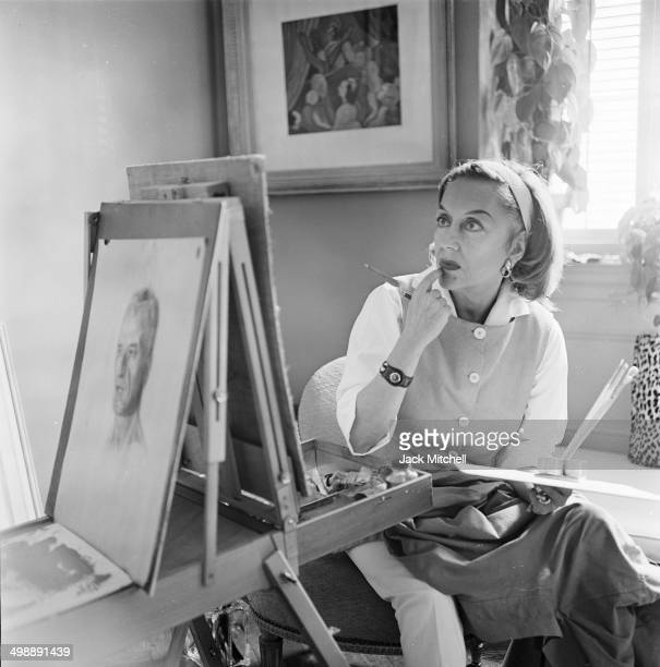 American actress Gloria Swanson paints a still life in her home New York New York 1965