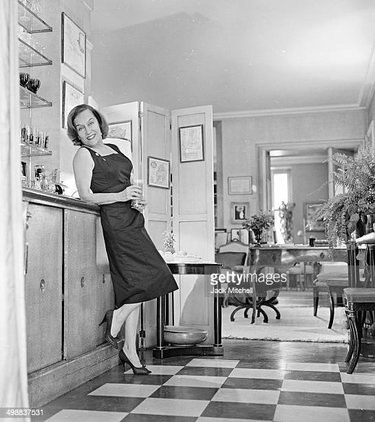 American actress Gloria Swanson prepares cocktails at her home New York New York 1960