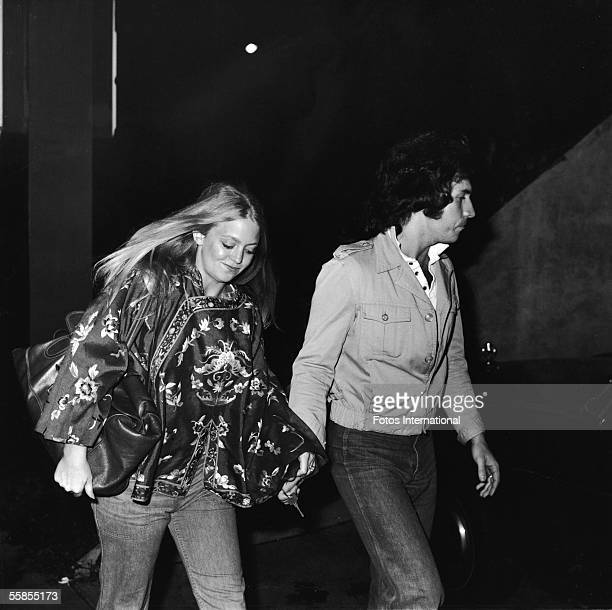 American actress Goldie Hawn and her second husband musician and television variety show host Bill Hudson arrive at the premiere of 'Taxi Driver'...
