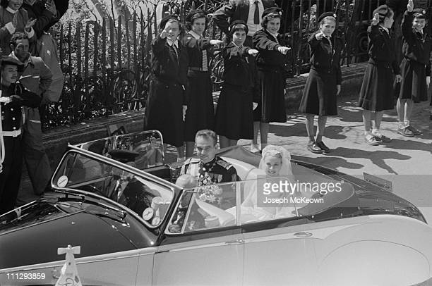 American actress Grace Kelly and Rainier III Prince of Monaco 1923 – 2005 are driven through the streets of Monte Carlo in a convertible car...