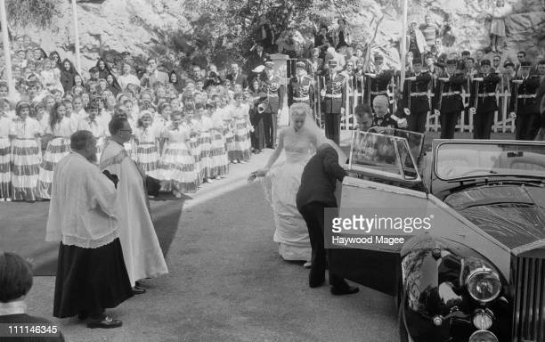 American actress Grace Kelly and Rainier III Prince of Monaco at the shine of St Devota on their wedding day Monaco 19th April 1956 Devota is the...