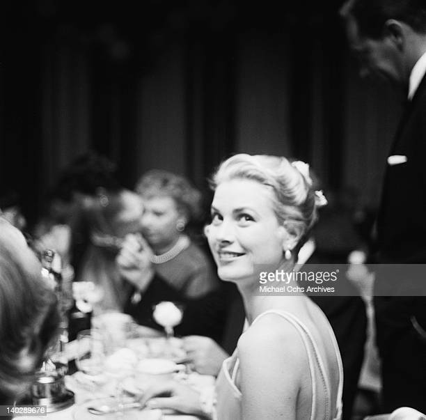 American actress Grace Kelly attends the Academy Awards at the Pantages Theatre in Hollywood, California, 30th March 1955.