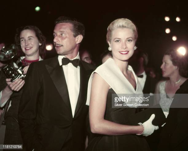 American actress Grace Kelly attends the premiere of the film 'Rear Window' with fashion designer Oleg Cassini , 1954.