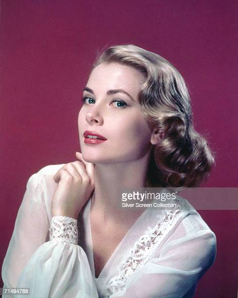 American actress Grace Kelly in a lacetrimmed top circa 1955