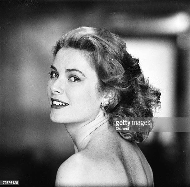 American actress Grace Kelly in a strapless gown as she looks over her shoulder, Hollywood, California, March 1954. The following April, Kelly...