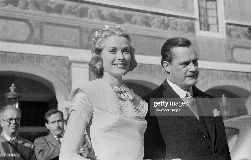 American actress Grace Kelly (1929 – 1982) on the day of her civil wedding to Rainier III, Prince of Monaco, at the Prince's Palace of Monaco, 18th April 1956. The man on the right is Count Fernand-Léopold-Marie-Joseph Caillard D'Aillieres, Prince Rainier's chamberlain. Original publication: Picture Post - 8336 - The Hour Of Marriage - pub. 28th April 1956