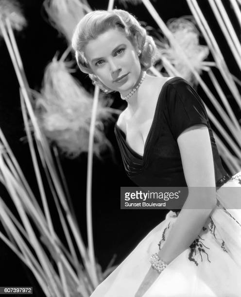 American actress Grace Kelly on the set of Rear Window directed and produced by British Alfred Hitchcock