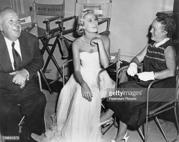 American actress Grace Kelly on the set of 'To Catch a Thief' with director Alfred Hitchcock and his wife Alma Reville at Paramount Studios Hollywood...