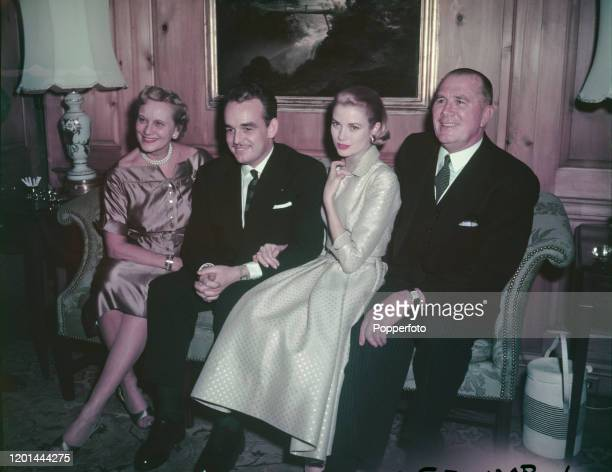 American actress Grace Kelly posed 3rd from left with her husband to be, Prince Rainier III of Monaco , seated 2nd from left, and her parents John B...