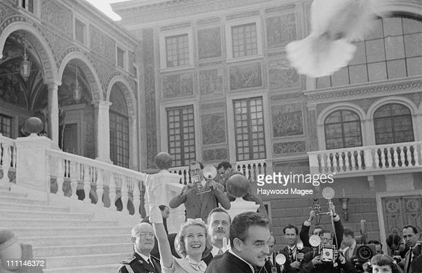 American actress Grace Kelly releases a white dove on the day of her civil wedding to Rainier III, Prince of Monaco , at the Prince's Palace of...