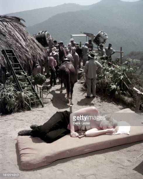 American actress Grace Kelly resting on the set of a film probably 'Mogambo' circa 1953