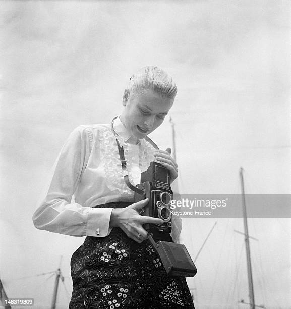 American actress Grace Kelly takes a picture in Cannes during the international film festival in April 26 May 10 1955 in Cannes France This is on...