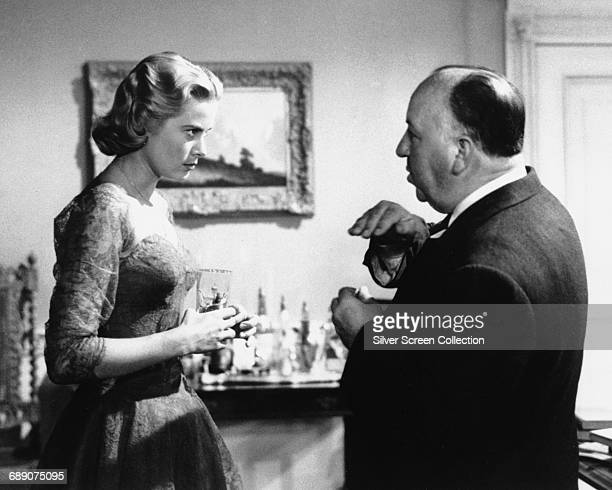 American actress Grace Kelly talking to director Alfred Hitchcock on the set of the film 'Dial M for Murder' 1954
