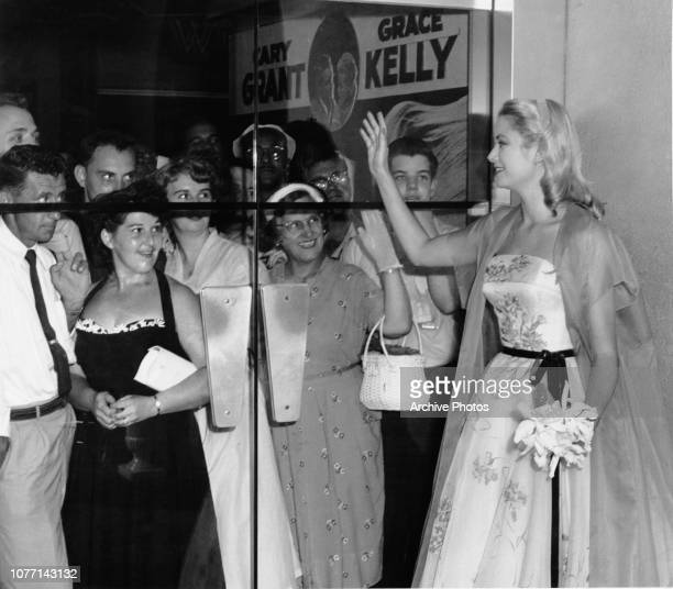 American actress Grace Kelly waves to fans at the premiere of her latest film 'To Catch a Thief' in Hollywood California 3rd August 1955