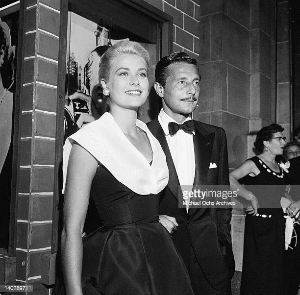 American actress Grace Kelly with fashion designer Oleg Cassini at the Hollywood premiere of the film 'Rear Window' 10th August 1954